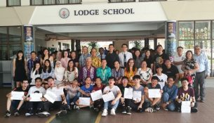 Lodge School 2017 SPM candidates posing for a group photo with their parents, teachers and members of the school management after receiving their result slips, yesterday.