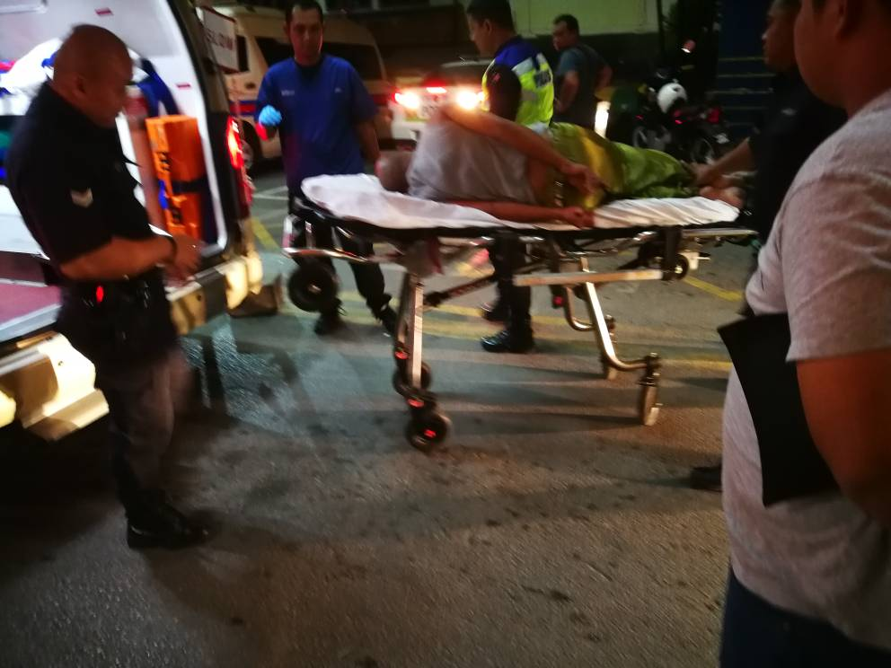 The man (on a stretcher) arrives at the Sarawak General Hospital.