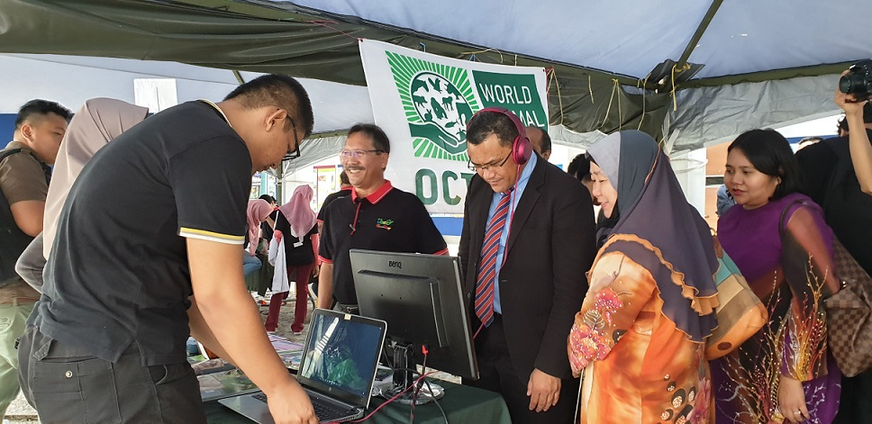 UNIMAS Deputy Vice-Chancellor, Professor Dr Wan Hashim Wan Ibrahim visiting the booths at the IBEC Open Day yesterday at the university.